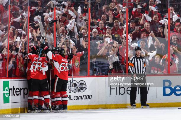 JeanGabriel Pageau of the Ottawa Senators celebrates his third period goal and third goal of the game for a hattrick against the New York Rangers...