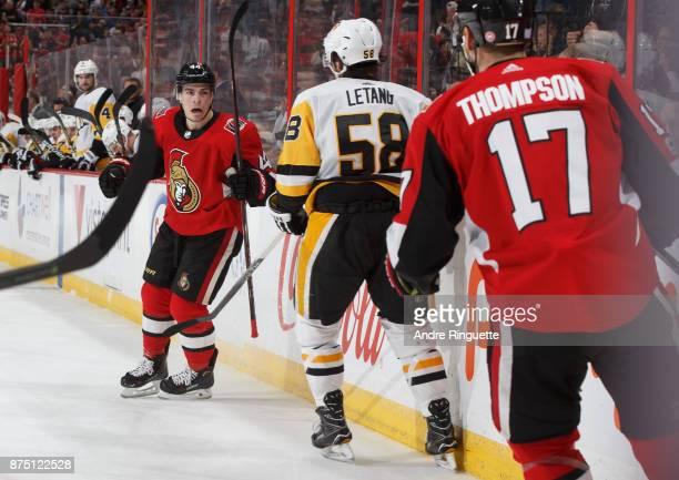 JeanGabriel Pageau of the Ottawa Senators celebrates his third period goal with teammate Nate Thompson as Kris Letang of the Pittsburgh Penguins...