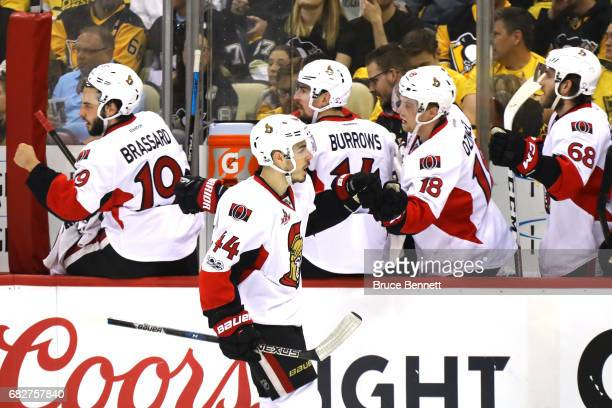 JeanGabriel Pageau of the Ottawa Senators celebrates with his teammates after scoring a goal against MarcAndre Fleury of the Pittsburgh Penguins...