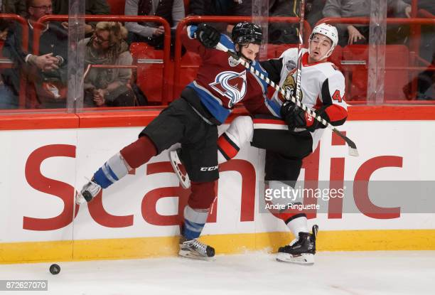 JeanGabriel Pageau of the Ottawa Senators collides with Alexander Kerfoot of the Colorado Avalanche along the boards at Ericsson Globe on November 10...