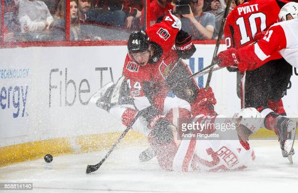 JeanGabriel Pageau of the Ottawa Senators collides with Mike Green of the Detroit Red Wings beating an icing call at Canadian Tire Centre on October...