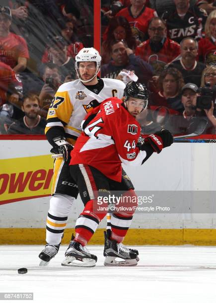 JeanGabriel Pageau of the Ottawa Senators collides with Sidney Crosby of the Pittsburgh Penguins during the first period in Game Six of the Eastern...