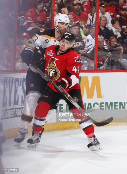 JeanGabriel Pageau of the Ottawa Senators collides with Zdeno Chara of the Boston Bruins in the end boards in Game Five of the Eastern Conference...