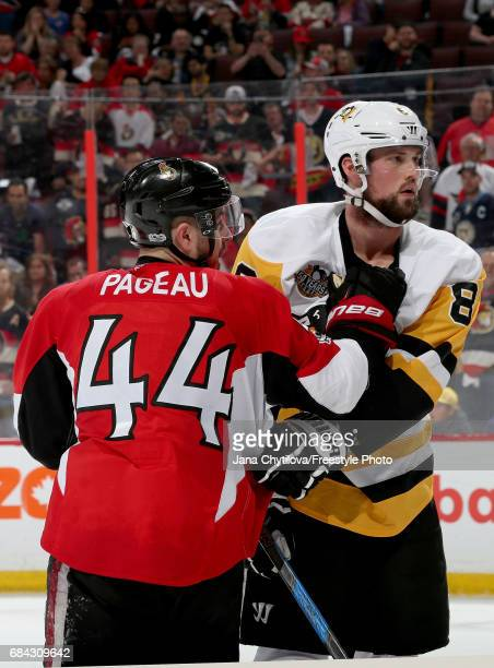 JeanGabriel Pageau of the Ottawa Senators fights with Brian Dumoulin of the Pittsburgh Penguins during the second period in Game Three of the Eastern...