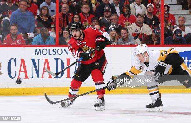 JeanGabriel Pageau of the Ottawa Senators fires a shot with pressure from Olli Maatta of the Pittsburgh Penguins in Game Six of the Eastern...