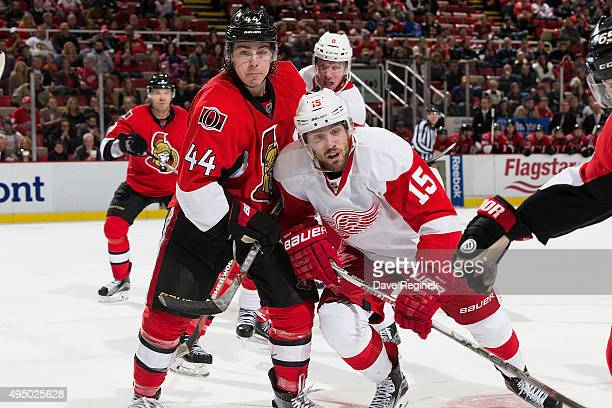 JeanGabriel Pageau of the Ottawa Senators follows the play with Riley Sheahan of the Detroit Red Wings during an NHL game at Joe Louis Arena on...