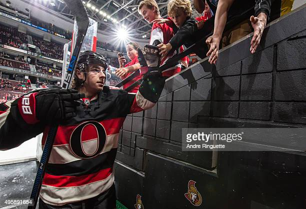 JeanGabriel Pageau of the Ottawa Senators highfives fans as he leaves the ice after warmup prior to a game against the Winnipeg Jets at Canadian Tire...