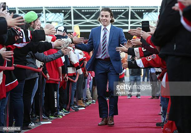 JeanGabriel Pageau of the Ottawa Senators highfives fans as he walks down the red carpet before the home opener against the Montreal Canadiens at...