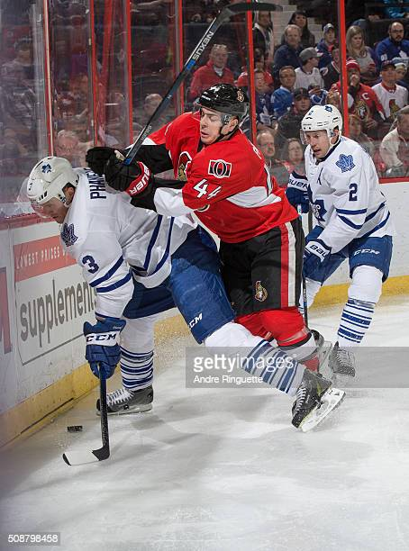JeanGabriel Pageau of the Ottawa Senators hits Dion Phaneuf of the Toronto Maple Leafs into the end boards from behind at Canadian Tire Centre on...