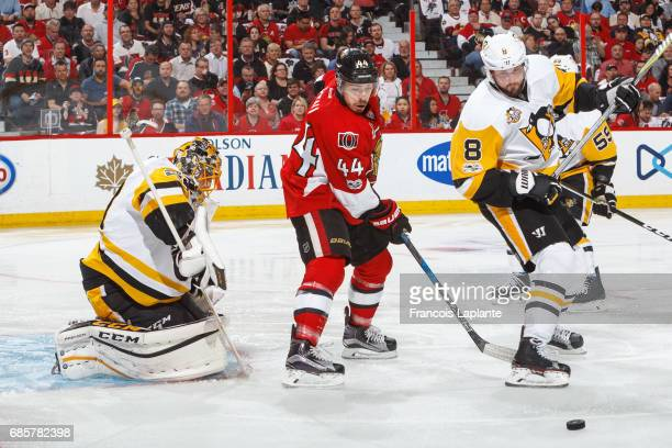 JeanGabriel Pageau of the Ottawa Senators looks for a rebound against MarcAndre Fleury of the Pittsburgh Penguins as Brian Dumoulin defends in Game...