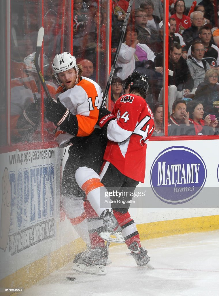 <a gi-track='captionPersonalityLinkClicked' href=/galleries/search?phrase=Jean-Gabriel+Pageau&family=editorial&specificpeople=7895476 ng-click='$event.stopPropagation()'>Jean-Gabriel Pageau</a> #44 of the Ottawa Senators pins <a gi-track='captionPersonalityLinkClicked' href=/galleries/search?phrase=Sean+Couturier&family=editorial&specificpeople=5663953 ng-click='$event.stopPropagation()'>Sean Couturier</a> #14 of the Philadelphia Flyers against the end boards on April 27, 2013 at Scotiabank Place in Ottawa, Ontario, Canada.