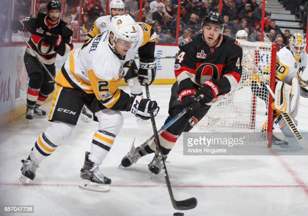 JeanGabriel Pageau of the Ottawa Senators pressures Chad Ruhwedel of the Pittsburgh Penguins on the forecheck as he stickhandles the puck at Canadian...