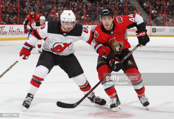 JeanGabriel Pageau of the Ottawa Senators races against Will Butcher of the New Jersey Devils to beat an icing call at Canadian Tire Centre on...