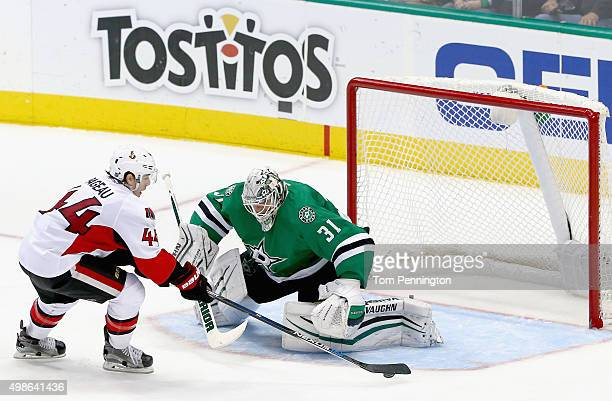 JeanGabriel Pageau of the Ottawa Senators scores a goal against Antti Niemi of the Dallas Stars in the third period at American Airlines Center on...
