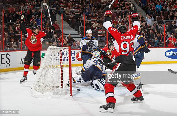 JeanGabriel Pageau of the Ottawa Senators scores the gametying goal with 01 seconds left on the clock against Jake Allen and Carl Gunnarsson of the...