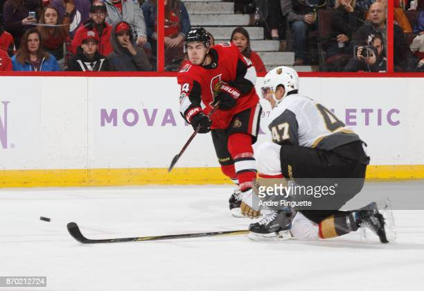 JeanGabriel Pageau of the Ottawa Senators shoots the puck against Luca Sbisa of the Vegas Golden Knights at Canadian Tire Centre on November 4 2017...