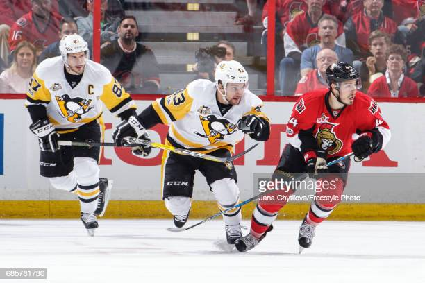 JeanGabriel Pageau of the Ottawa Senators skates against Conor Sheary and Sidney Crosby of the Pittsburgh Penguins in Game Three of the Eastern...