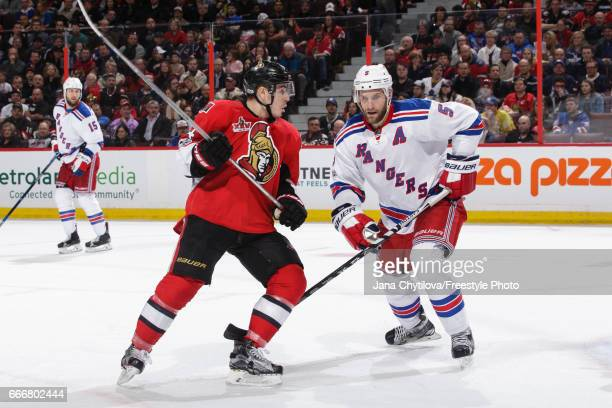 JeanGabriel Pageau of the Ottawa Senators skates against Dan Girardi of the New York Rangers at Canadian Tire Centre on April 8 2017 in Ottawa...