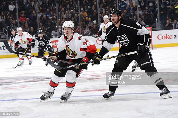 JeanGabriel Pageau of the Ottawa Senators skates against Jamie McBain of the Los Angeles Kings at STAPLES Center on February 26 2015 in Los Angeles...