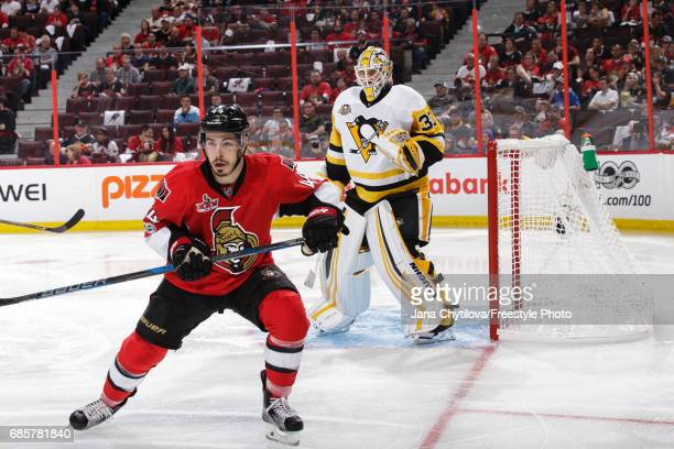 JeanGabriel Pageau of the Ottawa Senators skates as Matt Murray of the Pittsburgh Penguins defends the net in Game Three of the Eastern Conference...