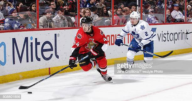 JeanGabriel Pageau of the Ottawa Senators skates with the puck as Matt Hunwick of the Toronto Maple Leafs gives chase during an NHL game at Canadian...