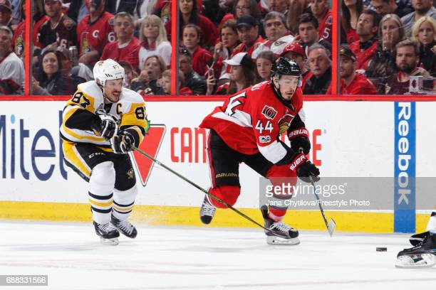 JeanGabriel Pageau of the Ottawa Senators skates with the puck against Sidney Crosby of the Pittsburgh Penguins in Game Six of the Eastern Conference...