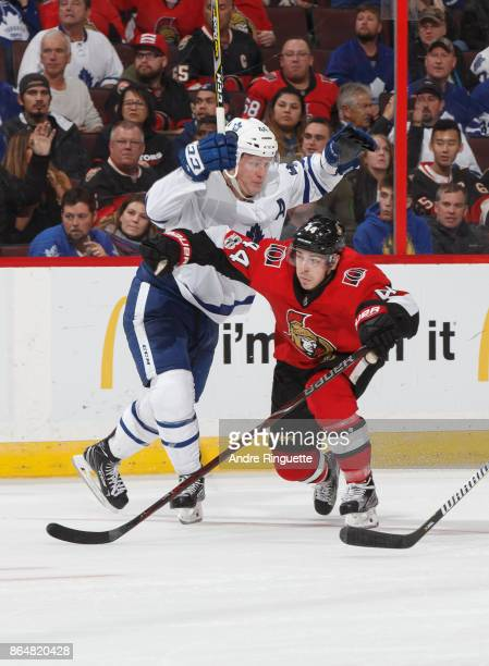 JeanGabriel Pageau of the Ottawa Senators squeezes by Morgan Rielly of the Toronto Maple Leafs at Canadian Tire Centre on October 21 2017 in Ottawa...