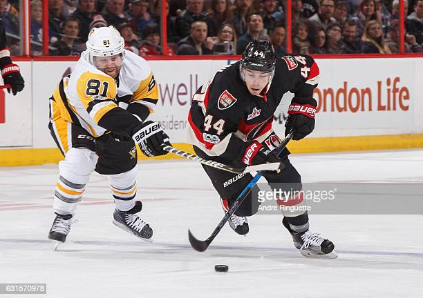 JeanGabriel Pageau of the Ottawa Senators stickhandles the puck across the blue line as Phil Kessel of the Pittsburgh Penguins reaches with his stick...