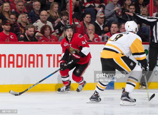 JeanGabriel Pageau of the Ottawa Senators stickhandles the puck with pressure from Brian Dumoulin of the Pittsburgh Penguins in Game Six of the...