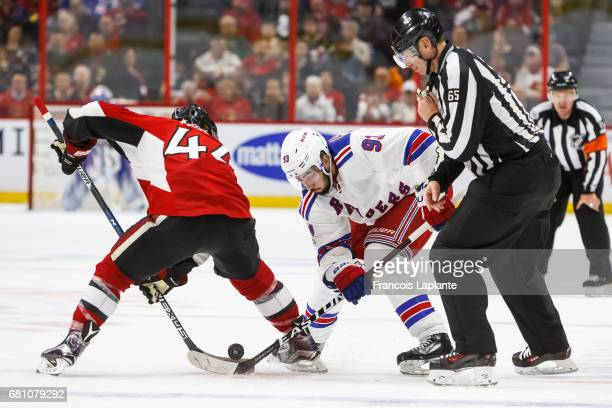 JeanGabriel Pageau of the Ottawa Senators takes a faceoff against Mika Zibanejad of the New York Rangers in Game Five of the Eastern Conference...