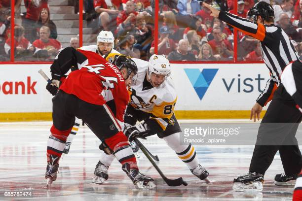 JeanGabriel Pageau of the Ottawa Senators takes a faceoff against Sidney Crosby of the Pittsburgh Penguins in Game Three of the Eastern Conference...