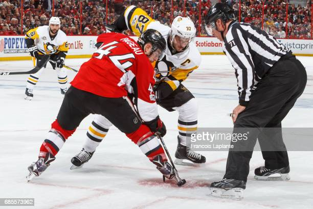 JeanGabriel Pageau of the Ottawa Senators takes a faceoff agaisnt Sidney Crosby of the Pittsburgh Penguins in Game Four of the Eastern Conference...