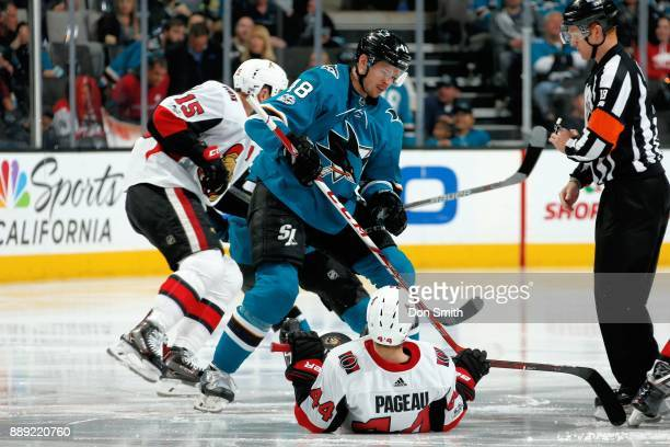 JeanGabriel Pageau of the Ottawa Senators takes a tumble after a faceoff against Tomas Hertl of the San Jose Sharks at SAP Center on December 9 2017...