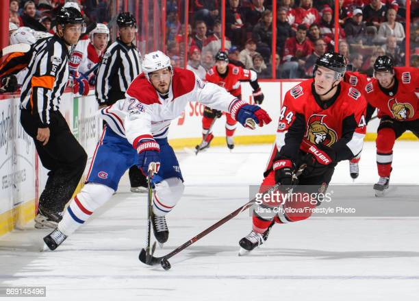 JeanGabriel Pageau of the Ottawa Senators tips the puck past Phillip Danault of the Montreal Canadiens at Canadian Tire Centre on October 30 2017 in...