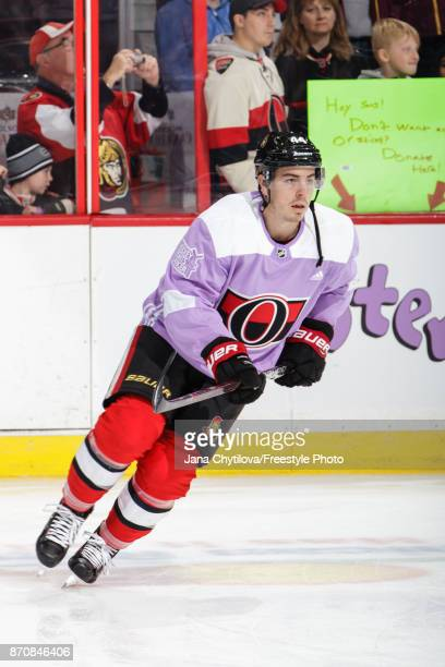JeanGabriel Pageau of the Ottawa Senators wears a jersey dedicated to the NHL's annual Hockey Fights Cancer Awareness Night as he skates during...