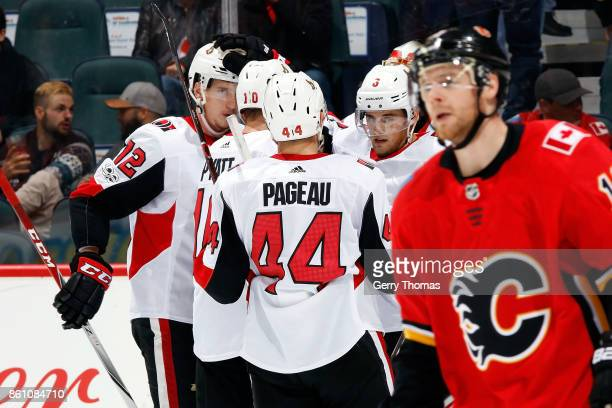 JeanGabriel Pageau Tom Pyatt and teammates of the Ottawa Senators celebrate a goal against the Calgary Flames during an NHL game on October 13 2017...