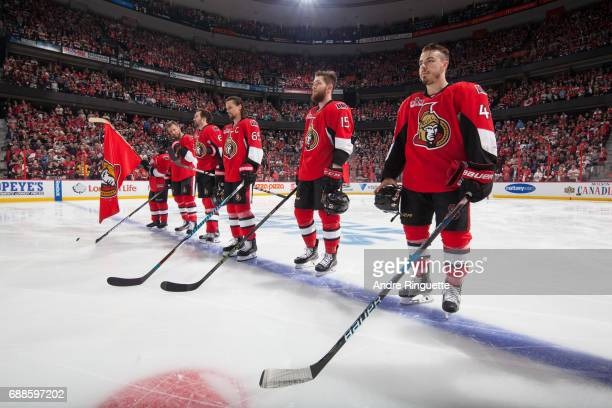 JeanGabriel Pageau Zack Smith Erik Karlsson Mark Stone and Marc Methot of the Ottawa Senators stand at attention during the singing of the national...