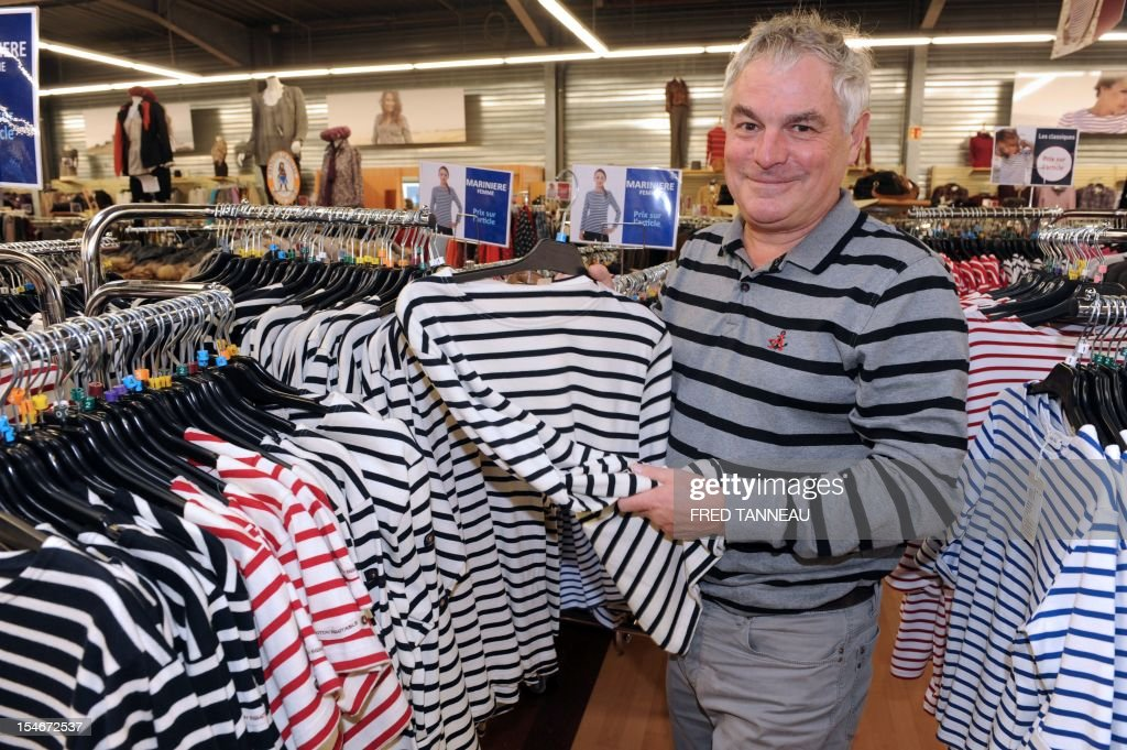 Jean-Guy Le Floch, Ceo of the factory Armor Lux, specialist of the Breton style knits, poses on October 24, 2012 in a shop Quimper, western France.