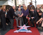 Jeanie Buss Phil Jackson Johnny Grant Eric Garcetti Jerry Buss Tom Arnold Earvin 'Magic' Johnson Paula Abdul