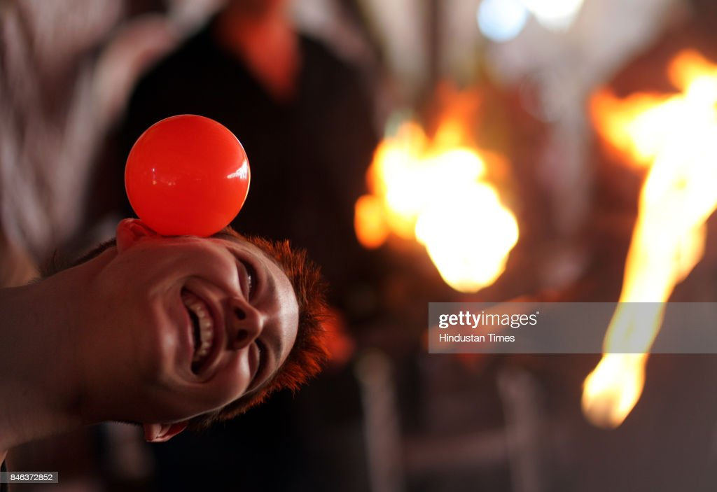 Jeanine Ebnother from Switzerland shows her contact juggling skills at the Empire Circus in Cross Maidan, Churchgate on Friday. Five foreign artistes from various parts of the world have been brought to perfrom in the circus for the first time. Richard Wright juggles with the fire.