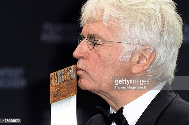 JeanJacques Annaud poses with the Cine Merit Award during the Munich Film Festival at Gasteig on June 29 2015 in Munich Germany