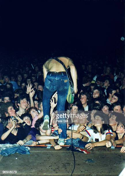 JeanJacques Burnel of The Stranglers steps headlong into the audience direct from the stage while performing at Bracknell Sports Centre on September...
