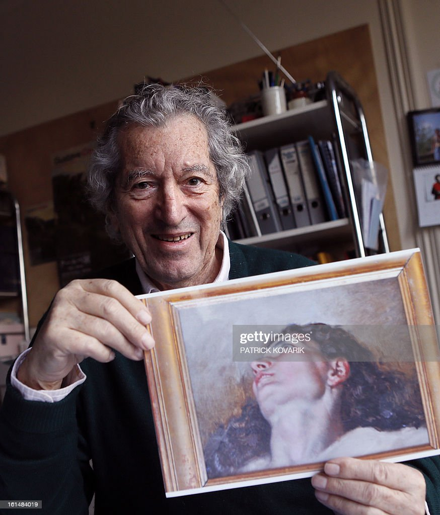 Jean-Jacques Fernier, French painting expert especially of Courbet, poses in his office on February 11, 2013 in Paris, with a reproduction of the allegedly head of the model of the French artist Gustave Courbet's painting (1819-1877) 'L'Origine du Monde' (The Origin of the World). Fernier believes he has solved the mystery of the model in a celebrated 19th century painting as a result of an art lover's 1,400 euro antique shop purchase that could turn out to be worth 40 million euros ($53.6 million), weekly Paris Match reported on February 7, 2013.