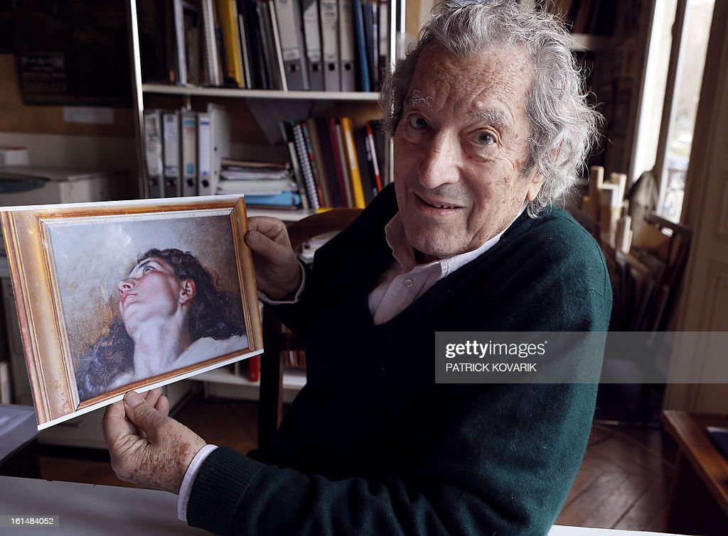 JeanJacques Fernier French painting expert especially of Courbet poses in his office on February 11 2013 in Paris with a reproduction of the...