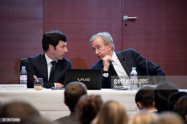 JeanJacques Guiony chief financial officer of LVMH Moet Hennessy Louis Vuitton SE left speaks with Bernard Arnault billionaire and chief executive...