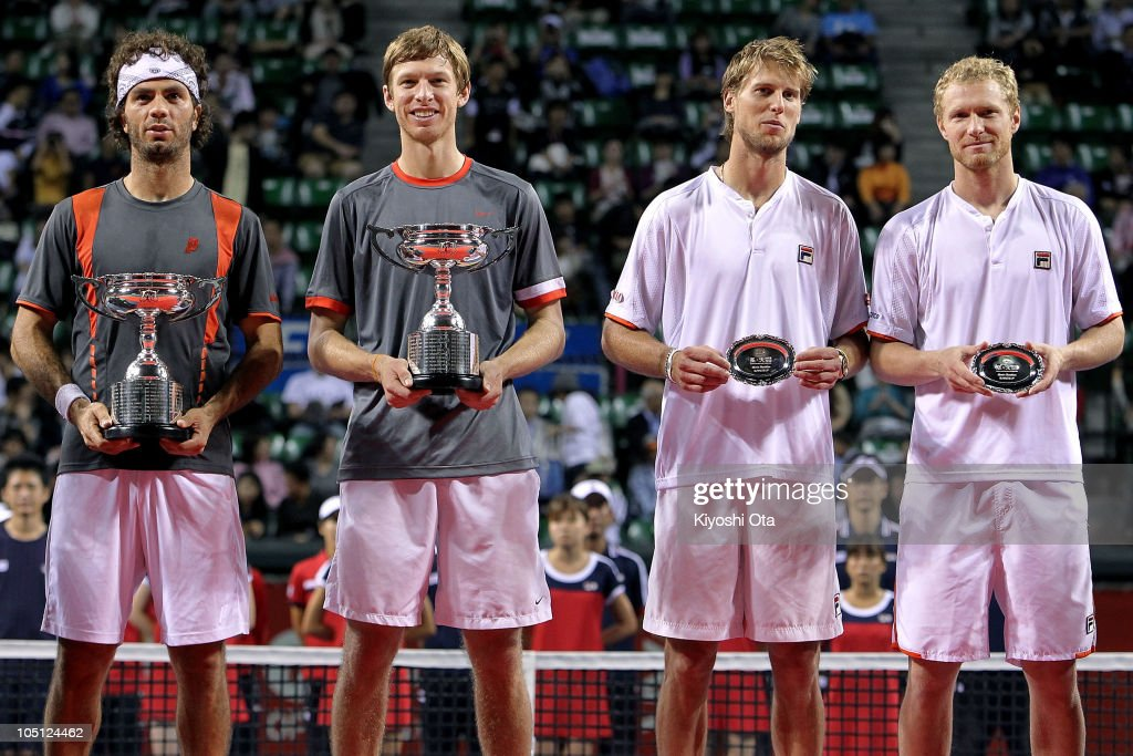 Jean-Julien Roger of the Netherlands Antilles and <a gi-track='captionPersonalityLinkClicked' href=/galleries/search?phrase=Eric+Butorac&family=editorial&specificpeople=736478 ng-click='$event.stopPropagation()'>Eric Butorac</a> of the United States, <a gi-track='captionPersonalityLinkClicked' href=/galleries/search?phrase=Andreas+Seppi&family=editorial&specificpeople=228727 ng-click='$event.stopPropagation()'>Andreas Seppi</a> of Italy and Dmitry Tursunov of Russia pose with trophies during the award ceremony after the Men's Doubles final match on day seven of the Rakuten Open tennis tournament at Ariake Colosseum on October 10, 2010 in Tokyo, Japan. <a gi-track='captionPersonalityLinkClicked' href=/galleries/search?phrase=Eric+Butorac&family=editorial&specificpeople=736478 ng-click='$event.stopPropagation()'>Eric Butorac</a> of the United States and Jean-Julien Roger of the Netherlands Antilles defeated <a gi-track='captionPersonalityLinkClicked' href=/galleries/search?phrase=Andreas+Seppi&family=editorial&specificpeople=228727 ng-click='$event.stopPropagation()'>Andreas Seppi</a> of Italy and Dmitry Tursunov of Russia 6-3, 6-2.