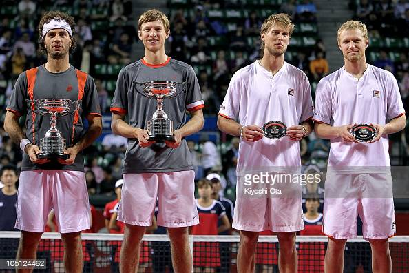 JeanJulien Roger of the Netherlands Antilles and Eric Butorac of the United States Andreas Seppi of Italy and Dmitry Tursunov of Russia pose with...