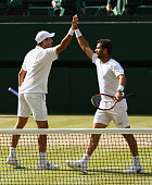 JeanJulien Rojer of Netherland celebrates playing with Horia Tecau of Romania in the Final Of The Gentlemen's Doubles against John Peers of Australia...