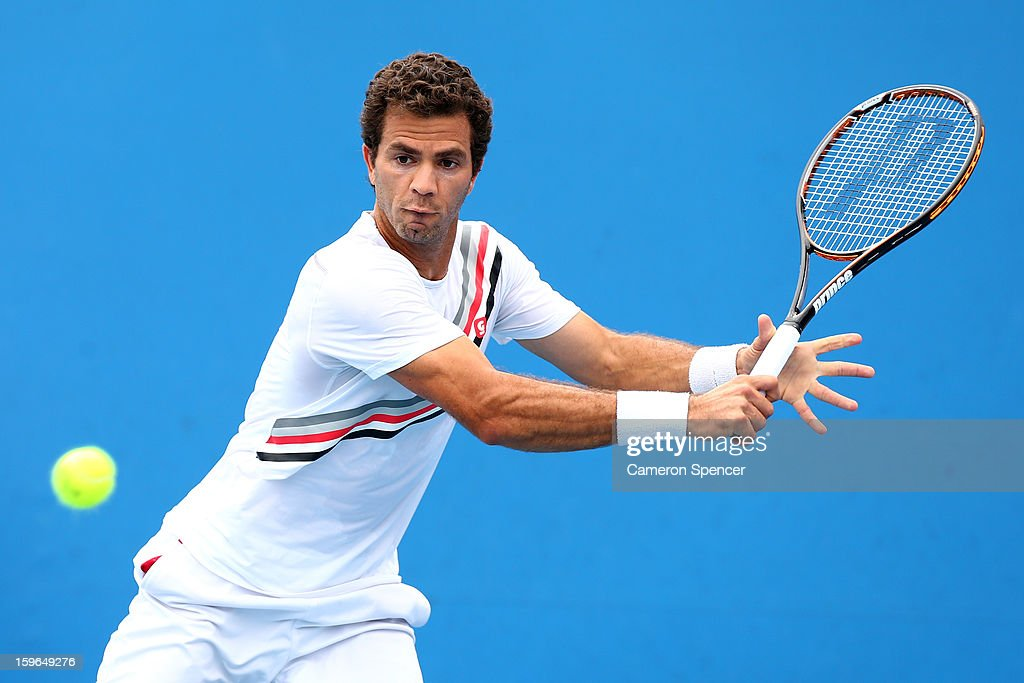 Jean-Julien Rojer of the Netherland plays a backhand in his second round doubles match with Aisam-Ul-Haq Qureshi of Pakistan against Xavier Malisse of Belgium and Dick Norman of Belgium during day five of the 2013 Australian Open at Melbourne Park on January 18, 2013 in Melbourne, Australia.