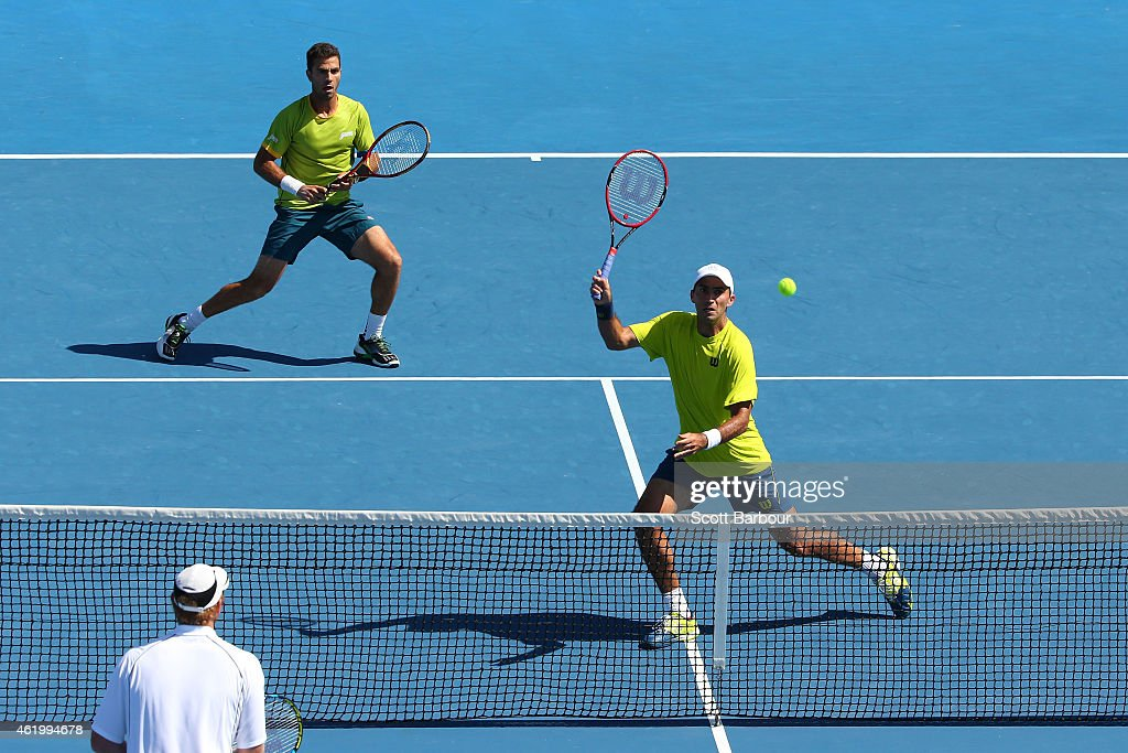 <a gi-track='captionPersonalityLinkClicked' href=/galleries/search?phrase=Jean-Julien+Rojer&family=editorial&specificpeople=5890489 ng-click='$event.stopPropagation()'>Jean-Julien Rojer</a> of the Netherlands and <a gi-track='captionPersonalityLinkClicked' href=/galleries/search?phrase=Horia+Tecau&family=editorial&specificpeople=820211 ng-click='$event.stopPropagation()'>Horia Tecau</a> of Romania in action in their second round doubles match against <a gi-track='captionPersonalityLinkClicked' href=/galleries/search?phrase=Chris+Guccione+-+Jogador+de+t%C3%A9nis&family=editorial&specificpeople=217596 ng-click='$event.stopPropagation()'>Chris Guccione</a> of Australia and Lleyton Hewitt of Australia during day five of the 2015 Australian Open at Melbourne Park on January 23, 2015 in Melbourne, Australia.
